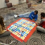 Students tying a no sew blanket
