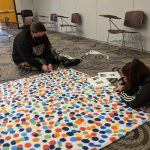 Students cutting a no sew blanket