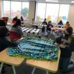 Students creating no sew blankets