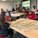 Students creating a blanket