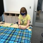 Student creating a blanket